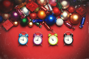 Four clocks near christmas gifts.