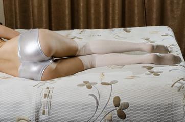 Sexy girl kneeling on bed
