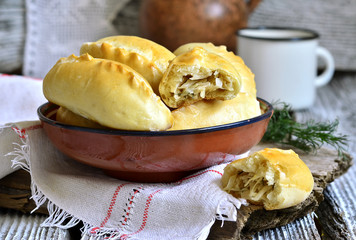 Baked patties with cabbage and dill.