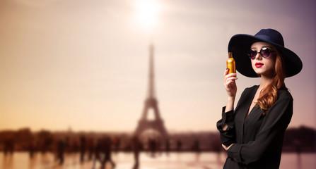 Elegance women with perfume bottle