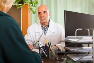 male doctor discharging  female patient