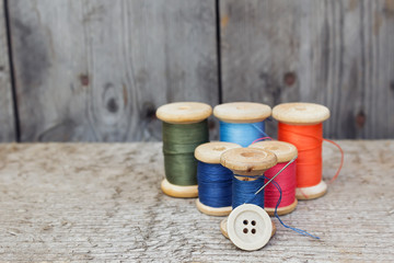 Vintage reels of thread and needle and button