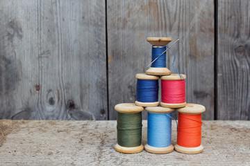 Vintage reels of thread  and needle