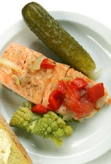 steamed salmon, green cauliflower on a white plate