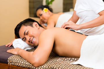 Indonesian couple having wellness massage