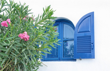 Traditional blue window on  white wall