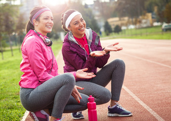 Two attractive female at the race track.Jogging pause.