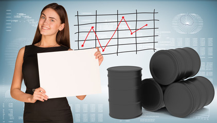 Businesswoman hold paper sheet. Black oil barrels are located