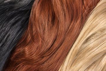 Long blond, black, red human shiny hair