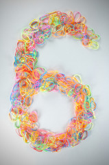 Number 6 from elastics hair-band with vignette frame.