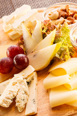 cheese plate with grapes