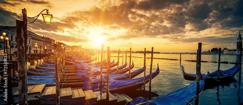 Panoramic view of Venice with gondolas at sunrise - 72569137