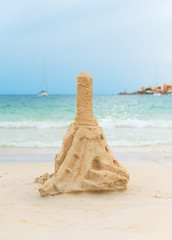 Tower from sand on the beach.