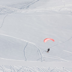 Paraglider in winter mountains of Georgia