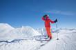 Skier is posing at camera