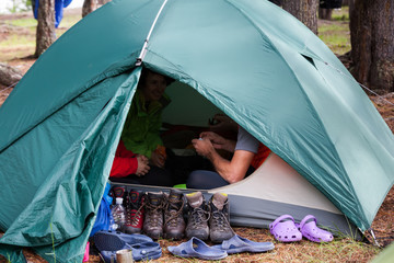 Backpackers is resing in tent with boots outdoor