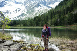 Portrait of hiker by mountain lake in Altai mountains, Russia