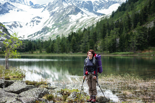 Portrait of hiker by mountain lake in Altai mountains, Russia © Maygutyak