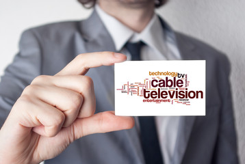 Cable television. Businessman in suit with a black tie showing o