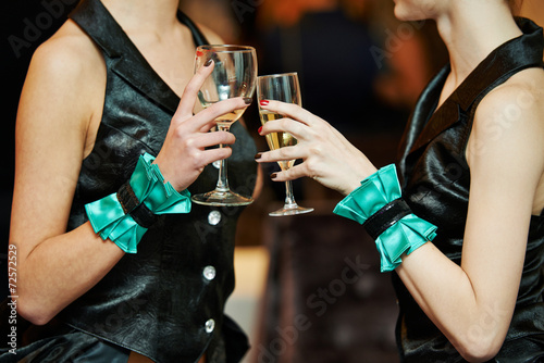 Guest hand and glass with wine at party - 72572529