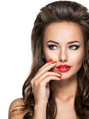 Beautiful woman with long hair and bright make up.