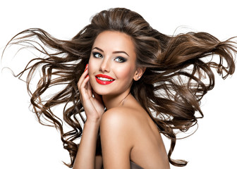 Beautiful laughing woman with long brown wavy hair.