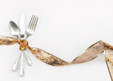 Silverware Wrapped with Hoilday Gold Ribbon