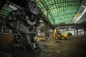 Industrial interior with bulldozer inside