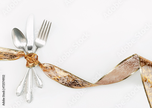 Silverware Wrapped with Hoilday Gold Ribbon - 72574932