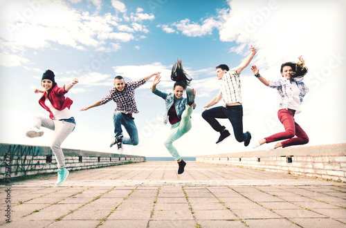 group of teenagers jumping - 72576327