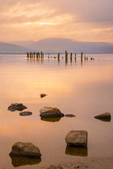 Loch Lomond jetty and mountains at sunset