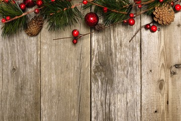 Aged wood Christmas background with branch and bauble top border