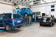 Leinwanddruck Bild - Cars In Garage