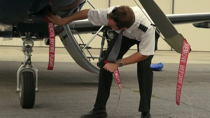 Pilot Attaches Ribbons to Aircraft (Remove Before Flight)