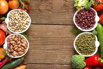 Legumes in bowls and vegetables