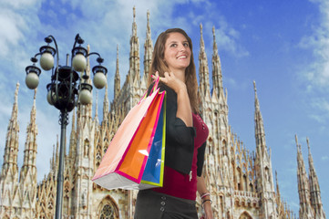Woman smiling while doing shopping in the city