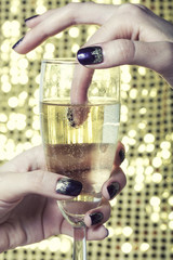 beauty close up photo fingers with manicure holding glass of
