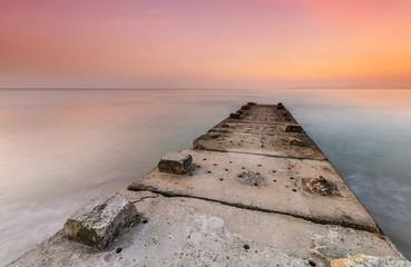 Stone jetty and calm seas