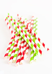 Paper drink straws on white background