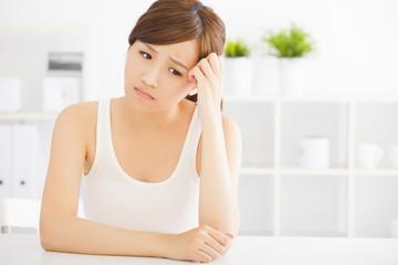 closeup sad young asian woman