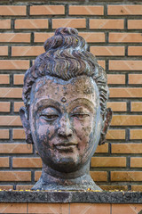 Ancient Head Buddha statue in Wat Umong, Chiang mai, thailand