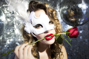 a beautiful sexy female with venetian carnival mask and rose