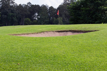 golf course with sand bunker and green grass