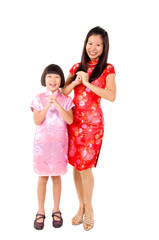 Chinese woman and daughter in wishing gesture