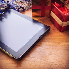 black tablet on table wood with christmas decoration