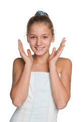 Joyful preteen girl against the white