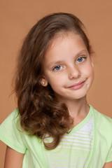 Little girl against an orange background