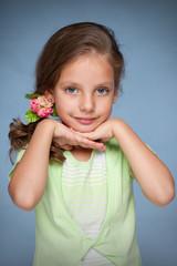 Pretty little girl against the blue