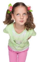 Funny little girl looks up