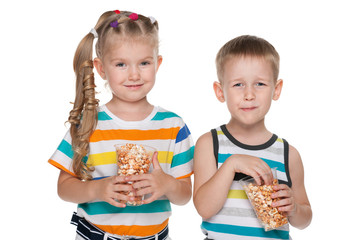Two children with popcorn